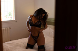 Charley Teasing in Black Lingerie in Bedroom